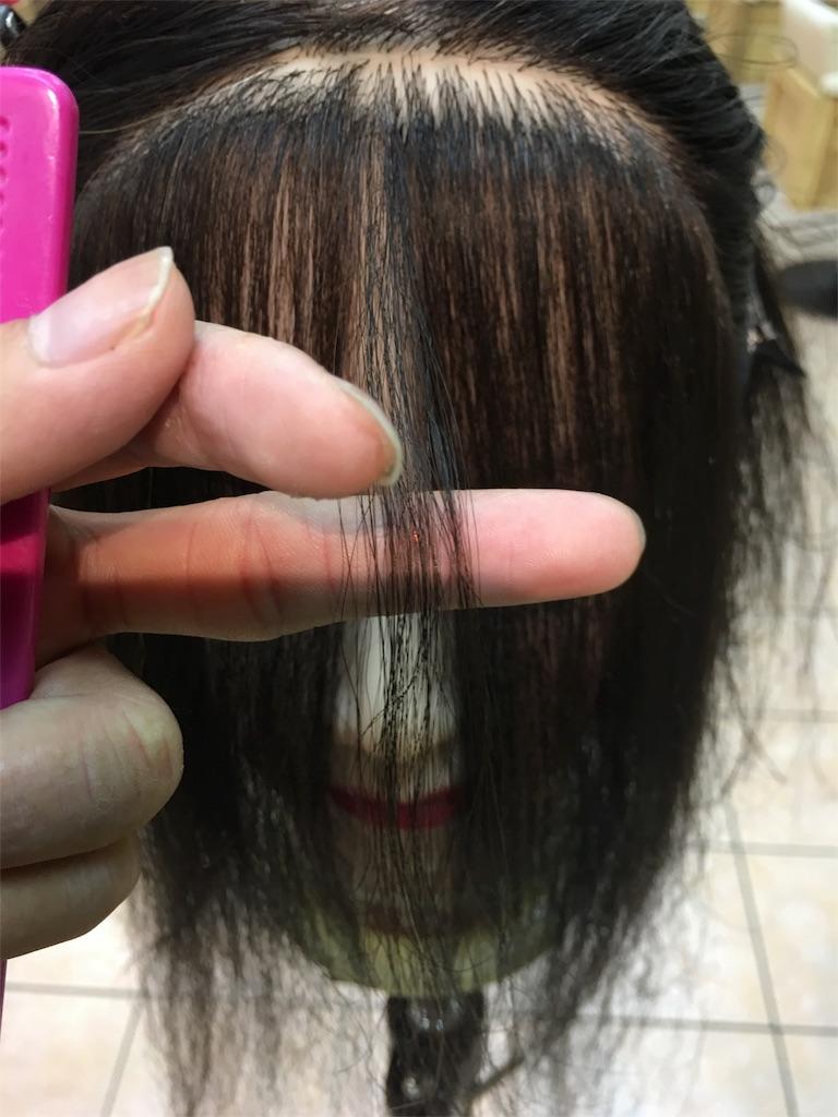 韓国女優イヨンヒのような流れる前髪のカット。