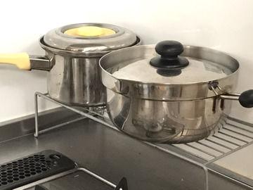 磨いた鍋の画像