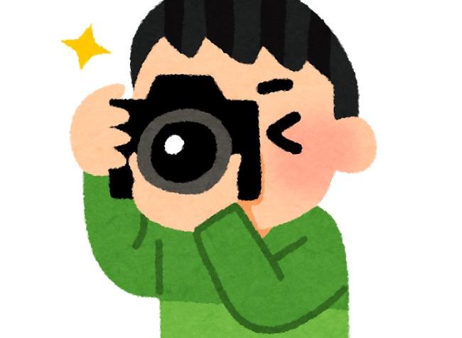 写真を撮ってるイラスト