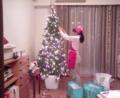 daughter decorates Xmas tree. fun!fun!fun!