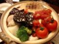 骨付チキンと色々野菜のトマト鍋。最後にリゾットに出来る。