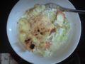 ちと古いご飯+クリームシチュー→レンジ+細長ネギ、塩胡椒+スライ