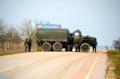 空港への道路を封鎖する軍車両 (20140301 あさひ 山尾有紀記者)