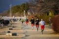 京都新聞写真コンテスト 河原でトレーニング