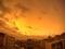 台風通過後の燃える夕焼け