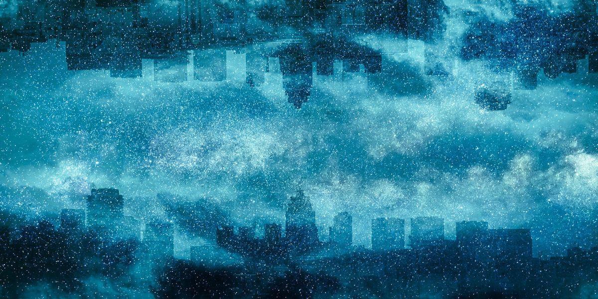 星空と街並みのシルエット(フォトモンタージュ)の写真素材