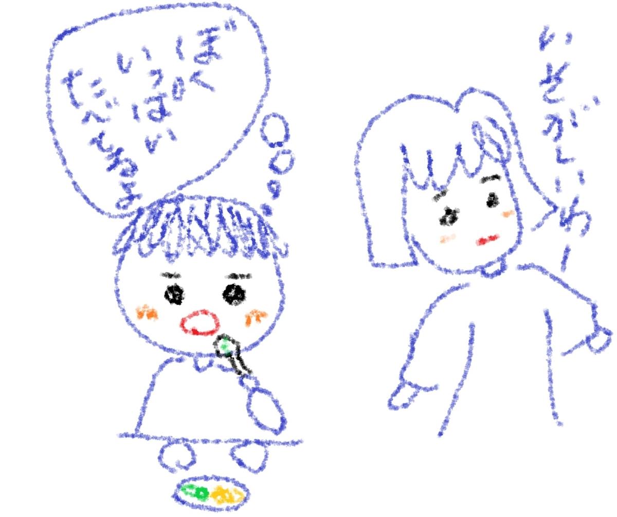 ご飯を食べる男の子と母親