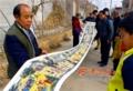 中国・陝西省 68歳の男性、長さ21メートルの「社火図」を描く