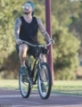 rides bicycle around the swan river in Perth 2018-03-05