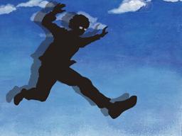 飛び降りる男