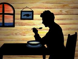 スープを飲む男