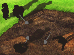 庭を掘り起こす警察官