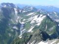 剣岳ピークから槍ヶ岳(左上のかすかな三角形)