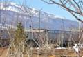 佐久平駅付近、浅間山を背に、新型車両E7系。(26.3.15)(16:14)
