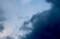 黒雲に飲み込まれそうな「六日のお月さま」。(28.9.6)(18:06)