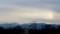 「八ヶ岳連峰」、上空に暗雲が棚引き、「彩雲」が…。(30.2.16)(16:50)