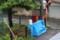 雨中の「古紙出し」、「ブルーシート」を掛けて…。(30.7.6)