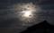 まだら雲を透かし、ほんのり淡い月の光が…。(30.9.24)