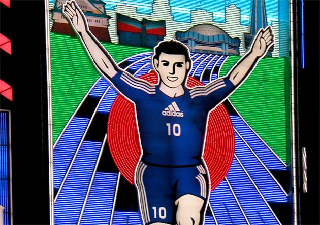 グリコの看板 日本代表チームのユニフォーム姿