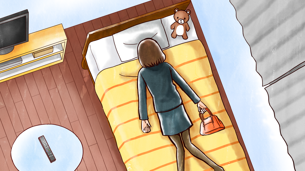 疲れてベッドに寝込む女性