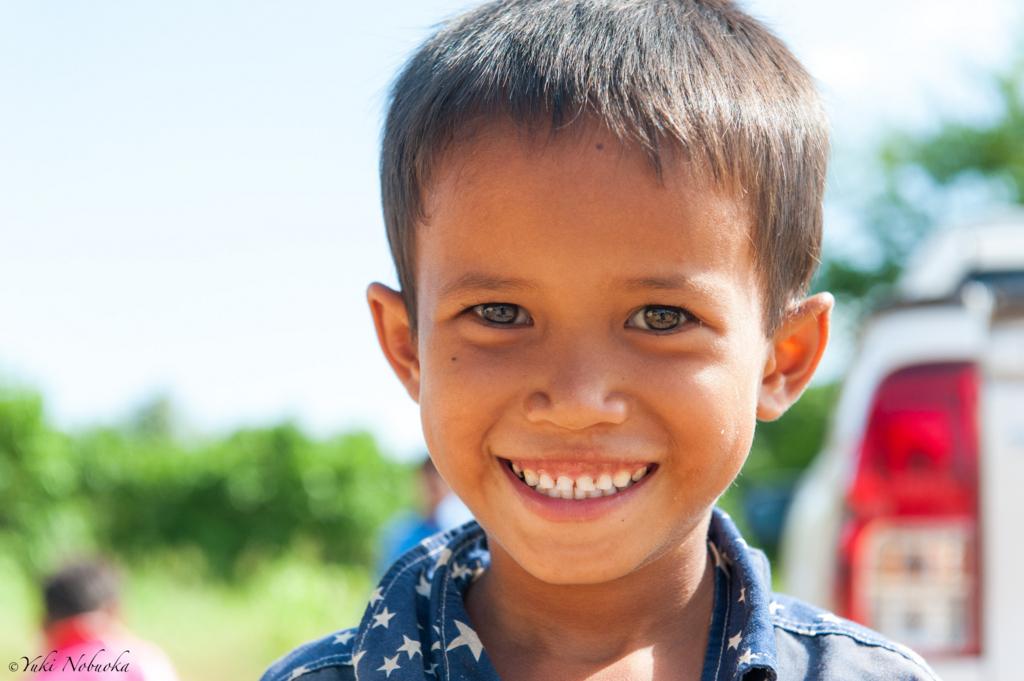 カンボジア 小学生の笑顔 photo by Yuki Nobuoka