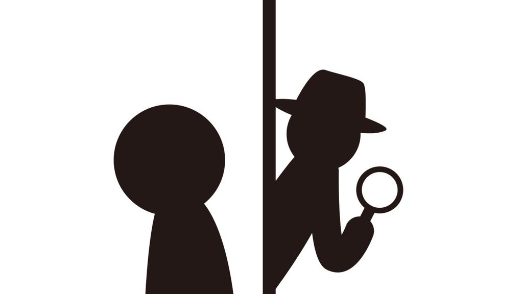 虫眼鏡を手にした探偵が立っているイラスト