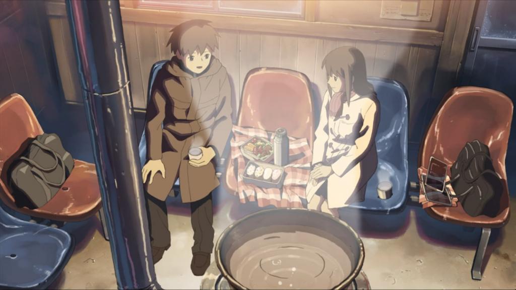 桜花抄の中の写真です。駅の待合室でお弁当を食べる二人の写真です